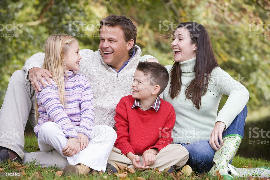 Family relaxing in autumn woodlands royalty-free stock photo