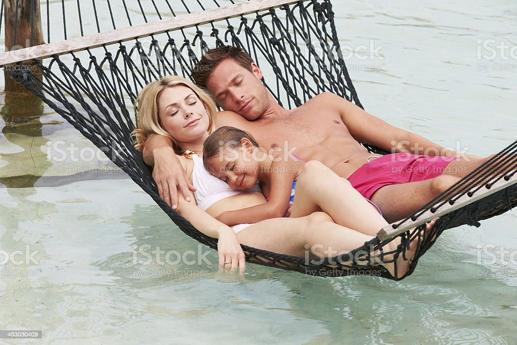 Family Relaxing In Beach Hammock royalty-free stock photo