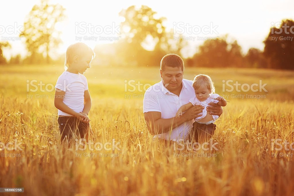 Family Relaxing In Summer Harvested Field royalty-free stock photo