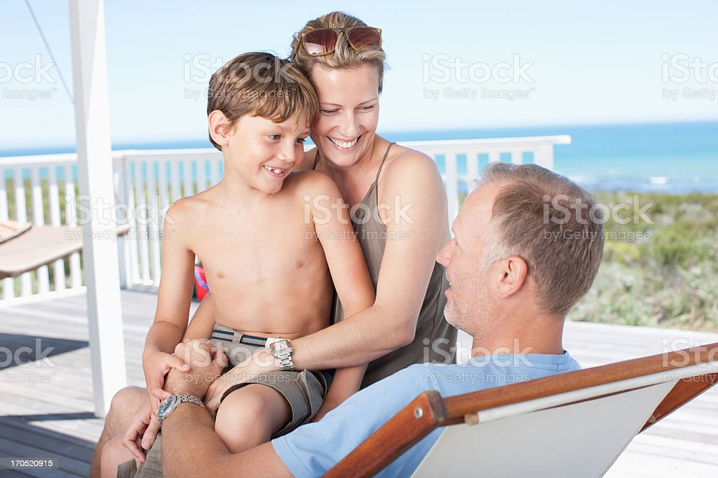 Family relaxing on deck royalty-free stock photo