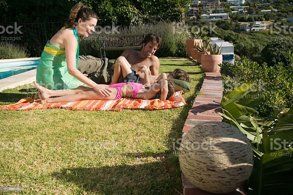 Family relaxing on holiday stock photo