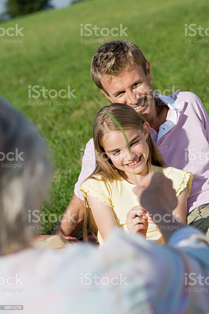 Family relaxing on the grass royalty-free stock photo