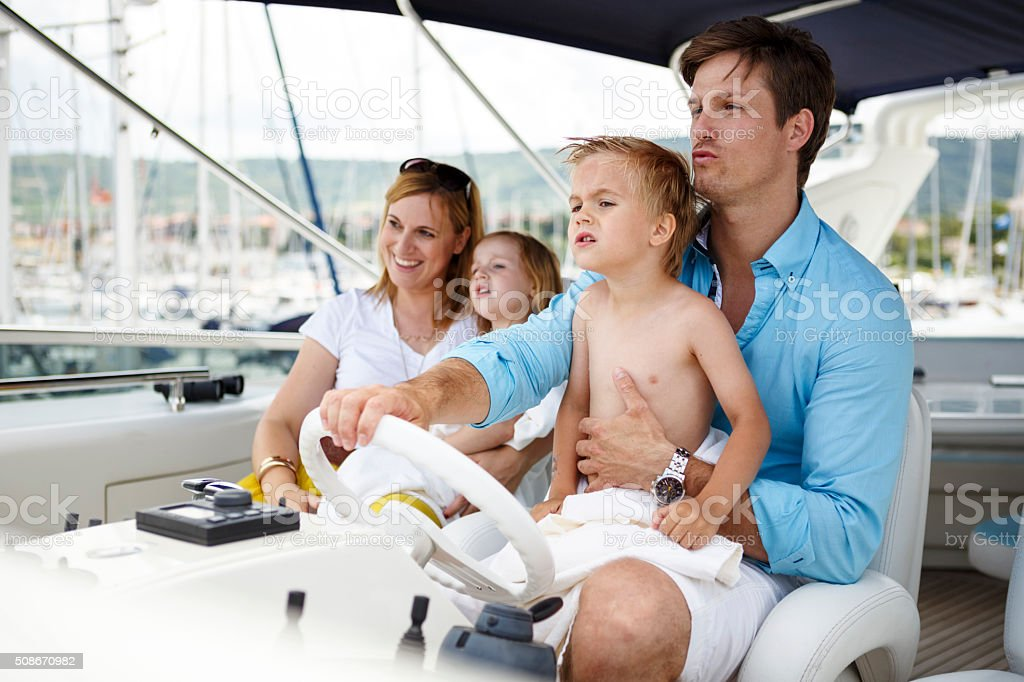 Family relaxing on yacht for holidays stock photo