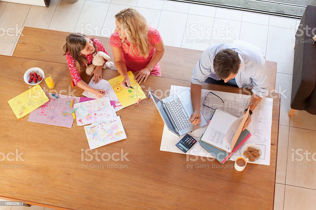 Family relaxing together at table stock photo