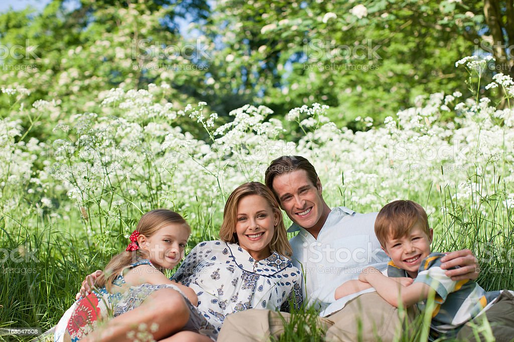 Family relaxing together in grass royalty-free stock photo