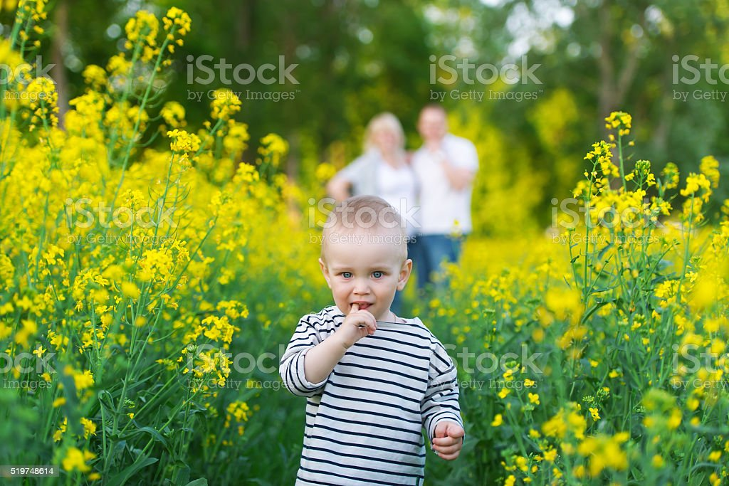 Family rest on the rape field. stock photo