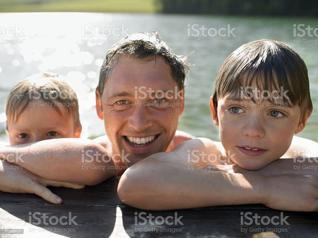 Family resting on a pier stock photo