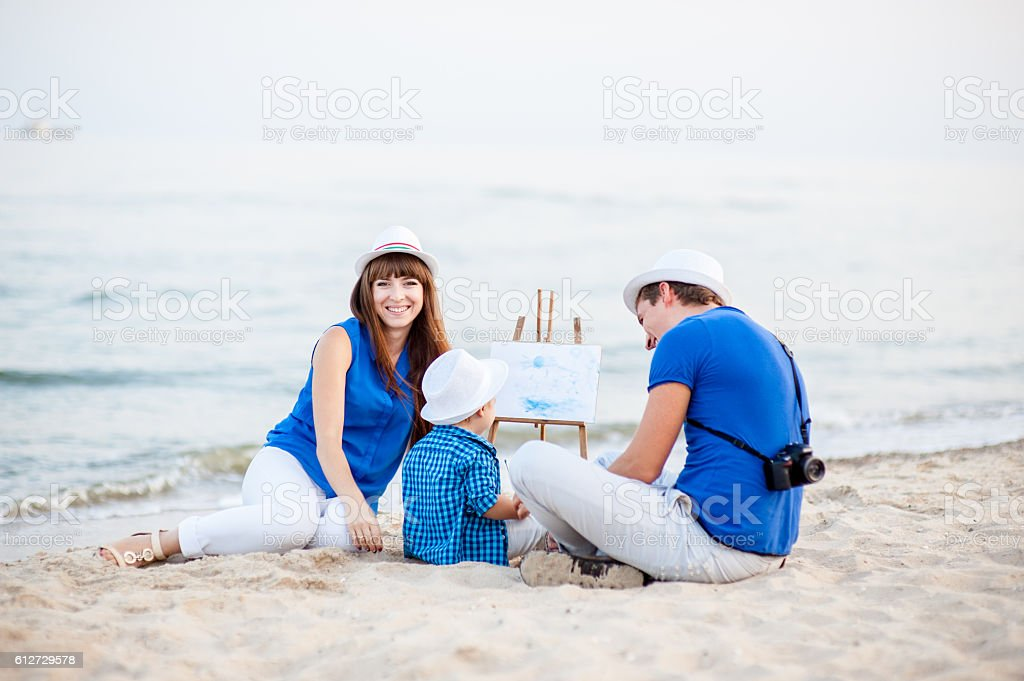 Family resting on the sea. stock photo