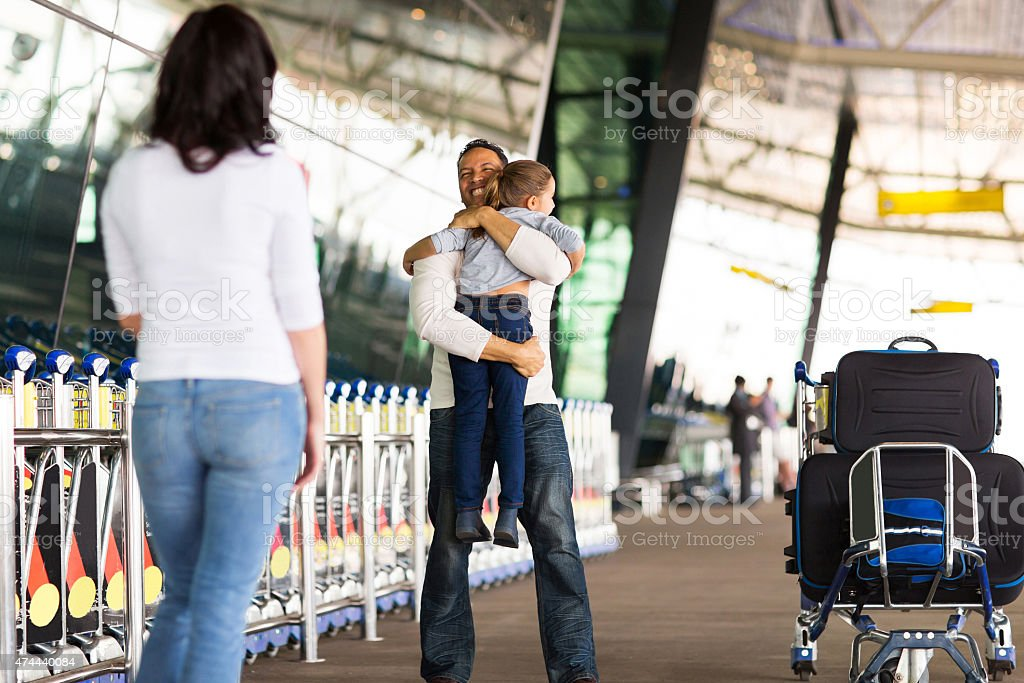 family reunion at airport stock photo