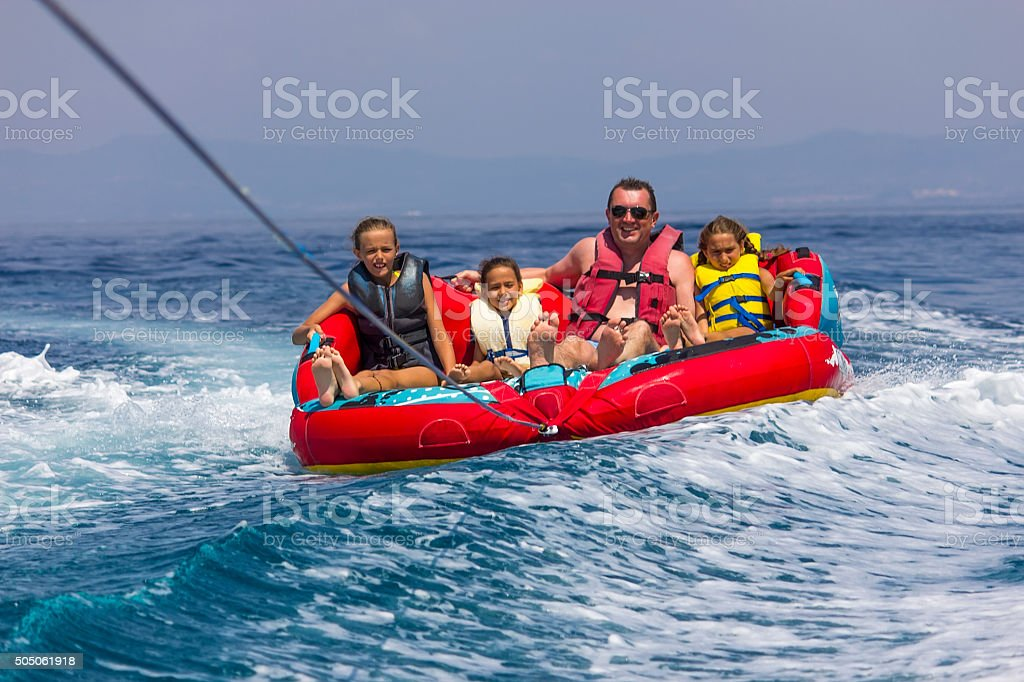 Family ride on the sea stock photo