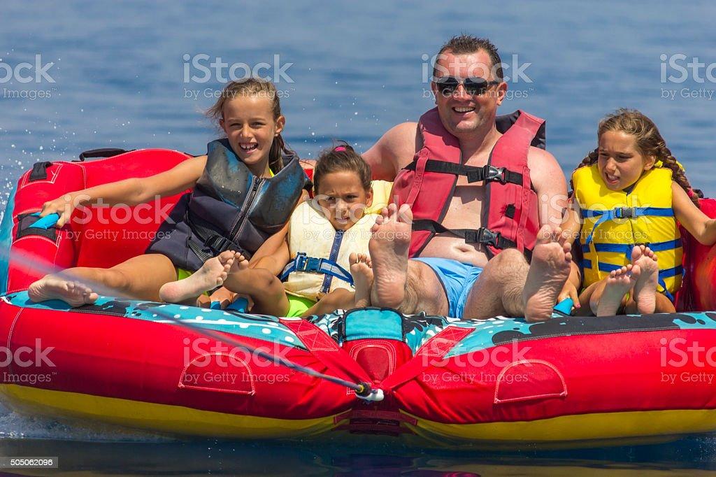 Family ride on the sea stock photo