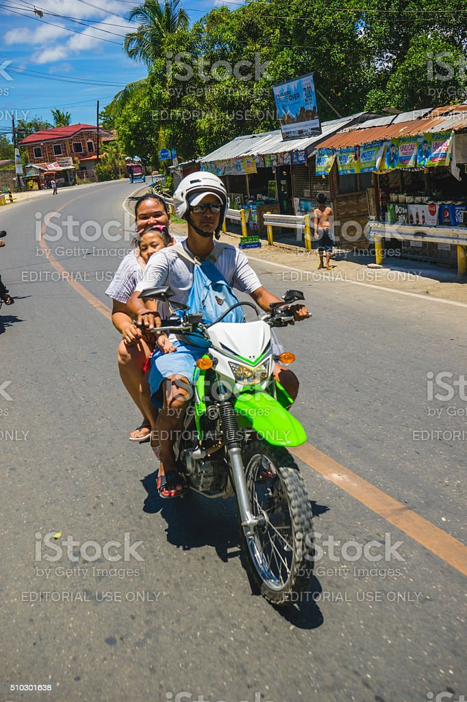 Family riding a motorbike in Cebu, Philippines stock photo