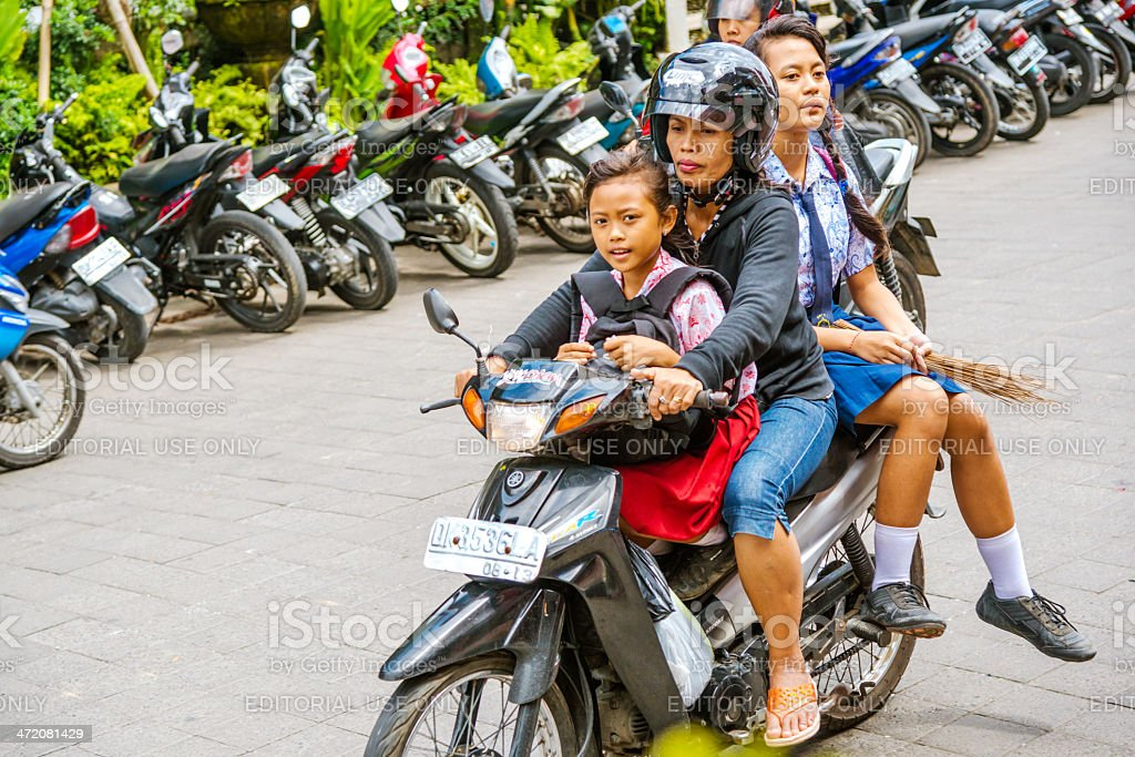 Family riding a Motorcycle royalty-free stock photo