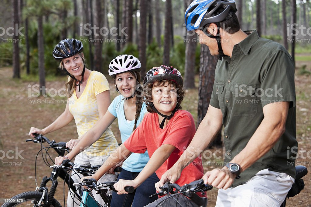 Family riding bicycles royalty-free stock photo