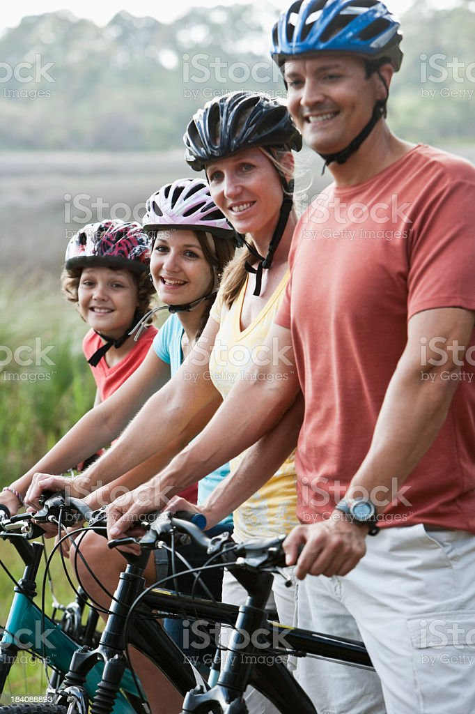 Family riding bicycles stock photo