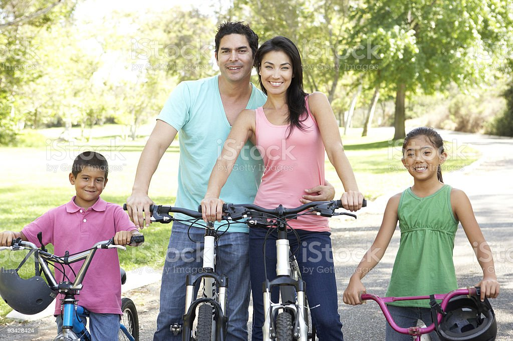 Family Riding Bikes In Park royalty-free stock photo
