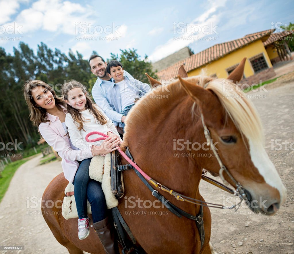 Family riding on horses stock photo