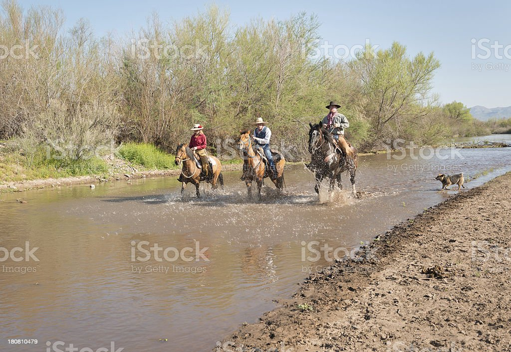 Family Riding up the river stock photo