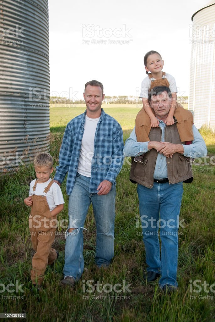A family roaming around the farm stock photo