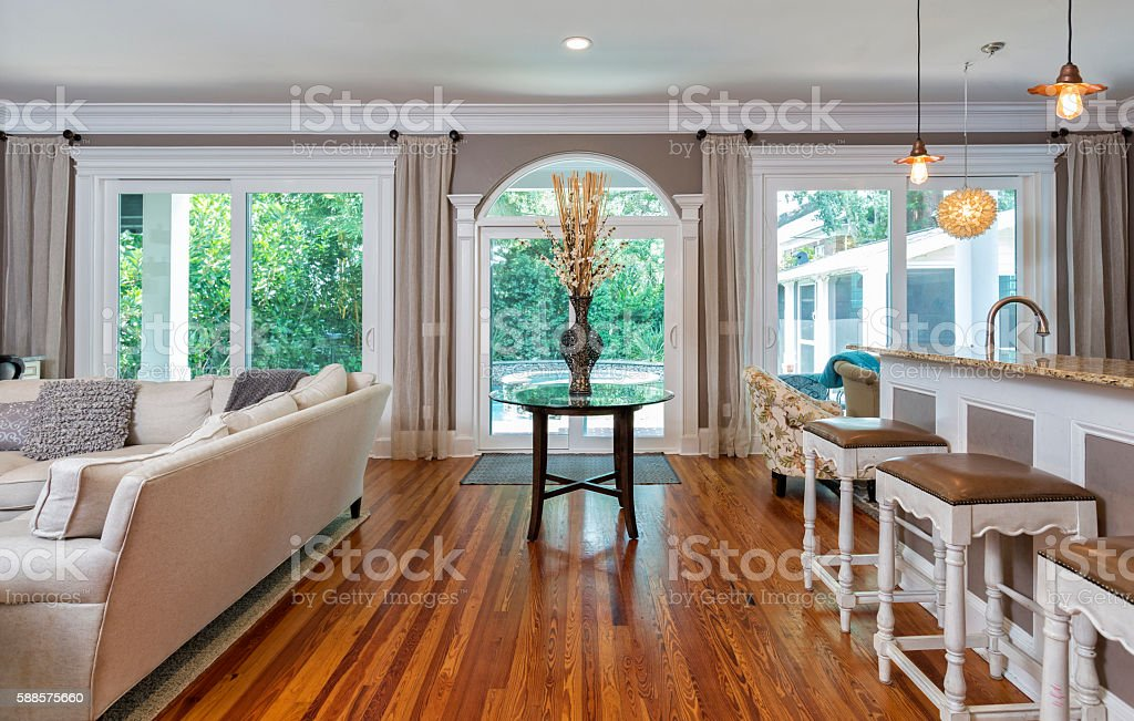Family Room and Kitchen Divided by a Centerpiece Table stock photo
