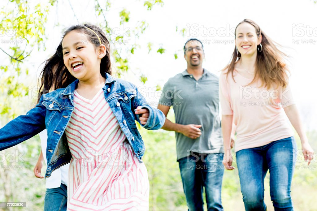 Family Running at a Park stock photo