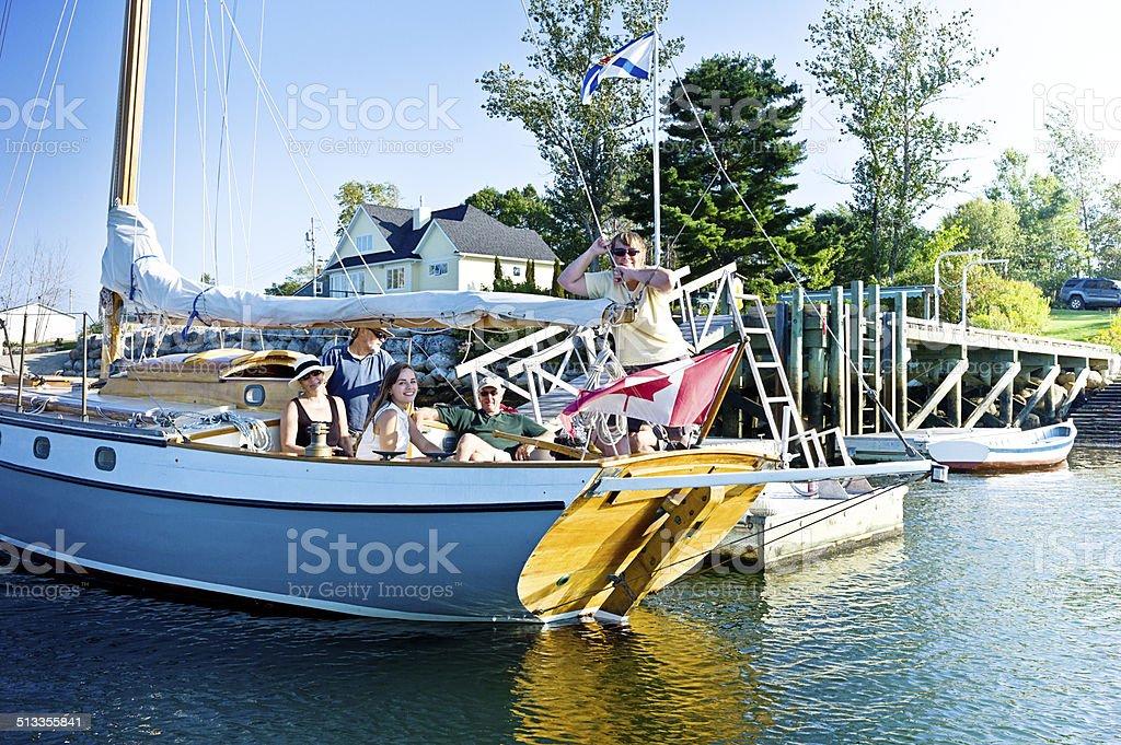 Family Sailing on Mahone Bay Nova Scotia stock photo