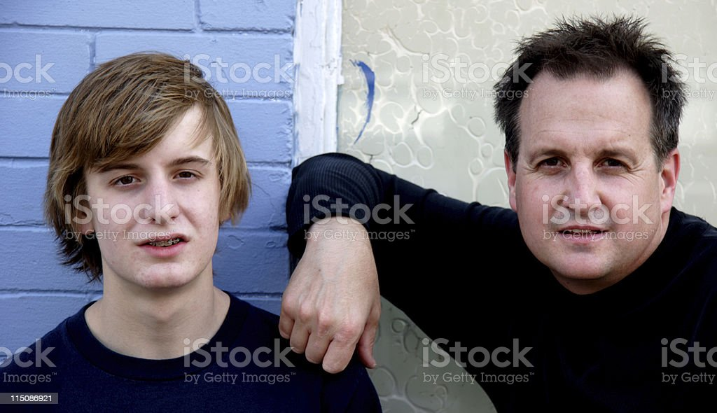 family scenes - attentive men father son royalty-free stock photo