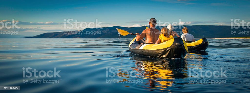 Family Sea Kayaking on a Sunny Day stock photo