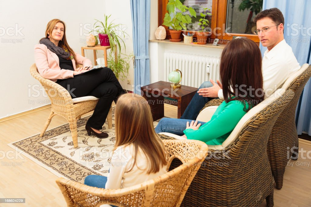 family seeing a psychotherapist royalty-free stock photo