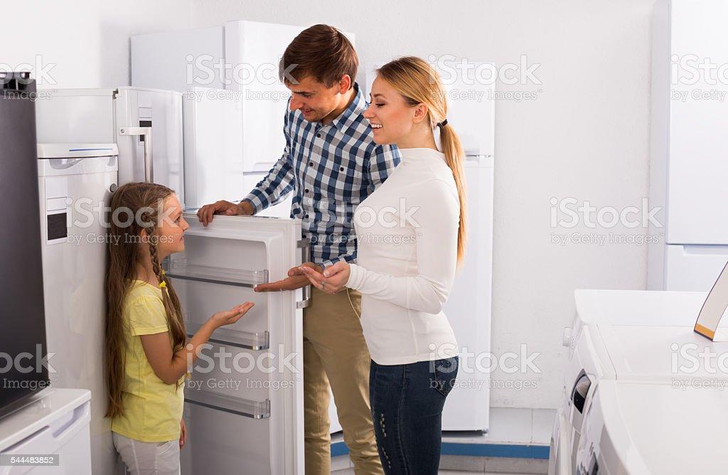 family selecting refrigerator stock photo