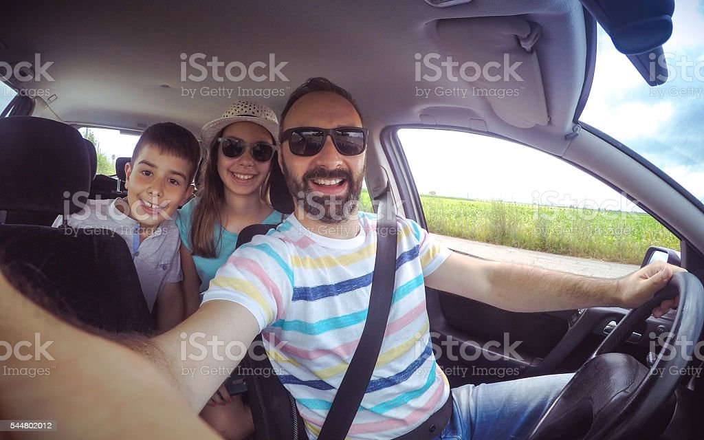 Family selfie in the car stock photo