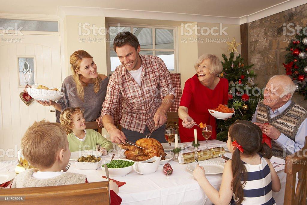 Family serving Christmas dinner stock photo