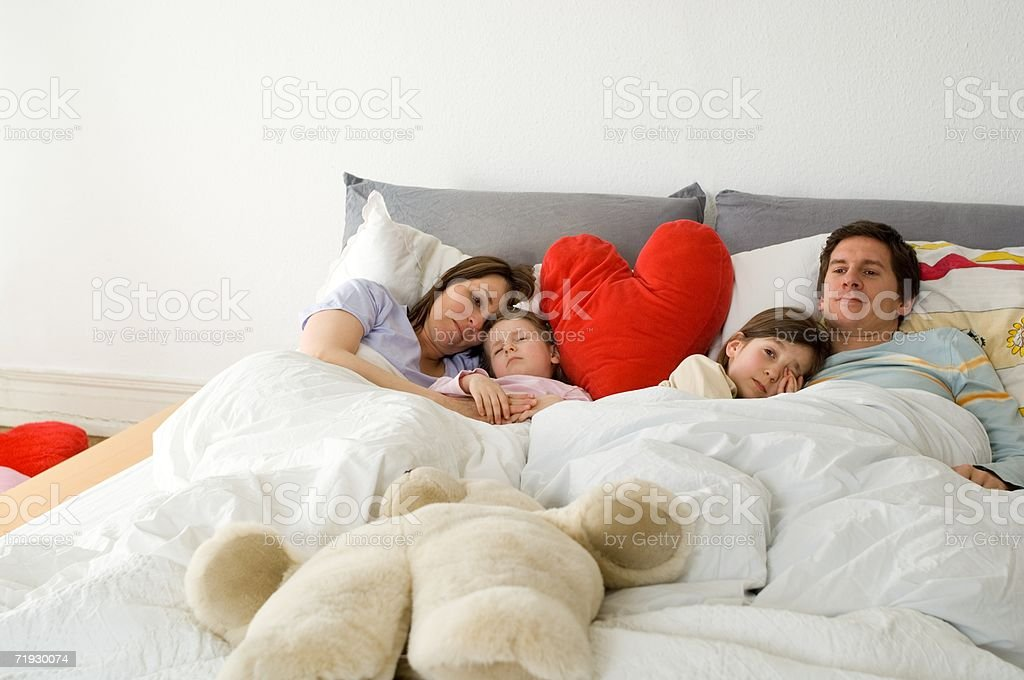 Family sharing a bed royalty-free stock photo