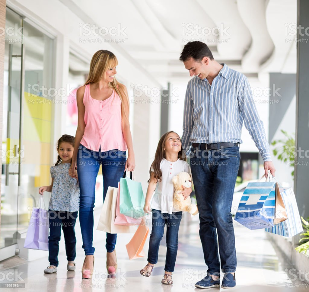 Family shopping at the mall stock photo
