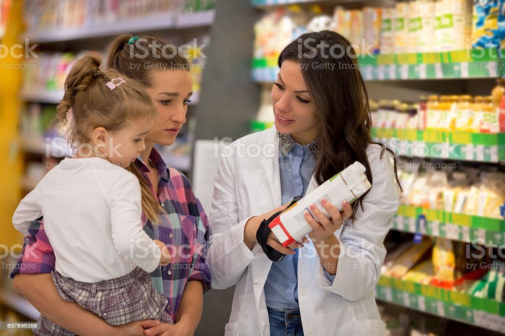 Family shopping for organic groceries stock photo