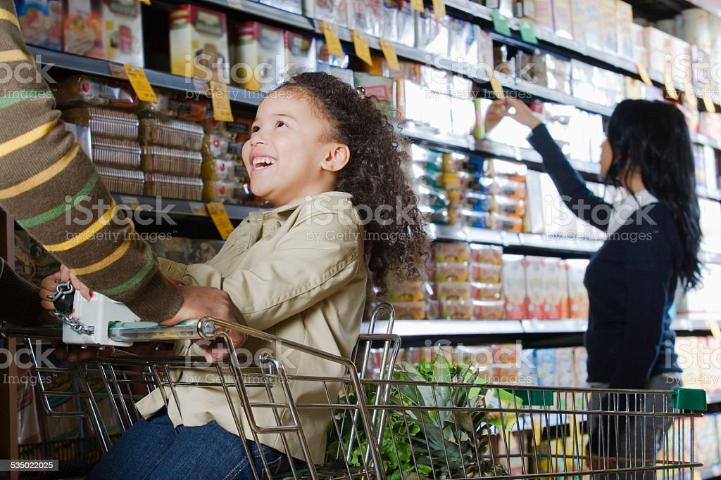 family shopping in a supermarket stock photo