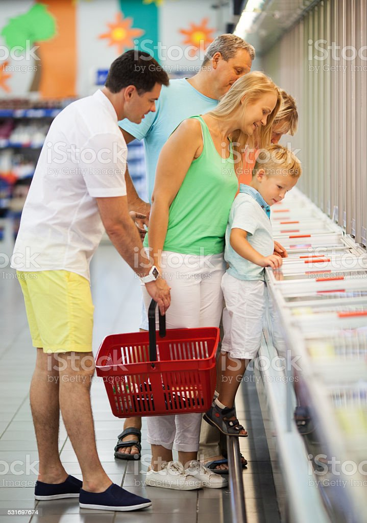 Family shopping together in a supermarket stock photo