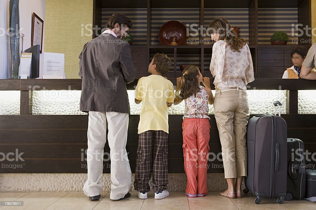 Family signing into hotel stock photo