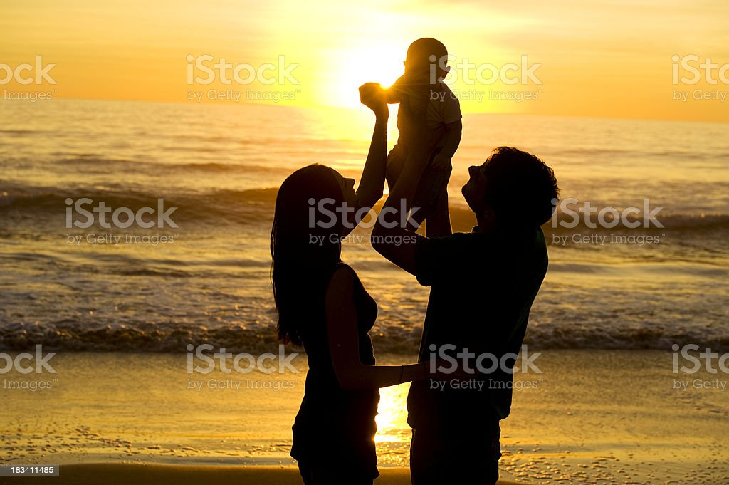 Family silhouette at the beach royalty-free stock photo