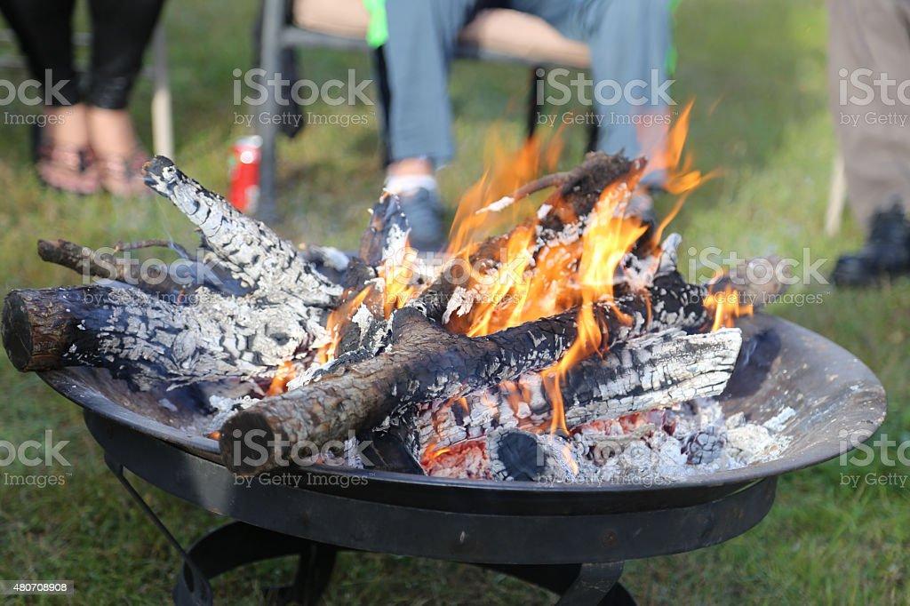 Family sitting around campfire royalty-free stock photo