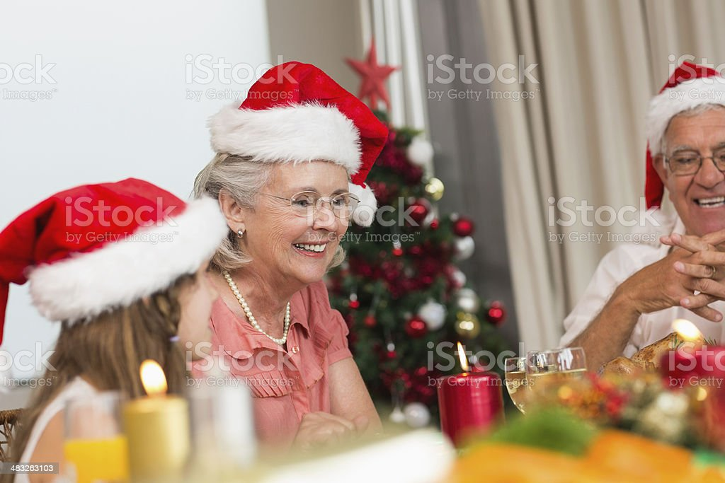 Family sitting at dining table during Christmas royalty-free stock photo