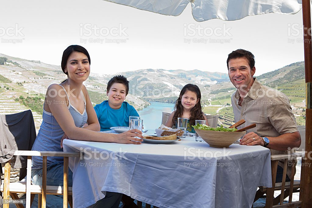 Family sitting at table on holiday royalty-free stock photo
