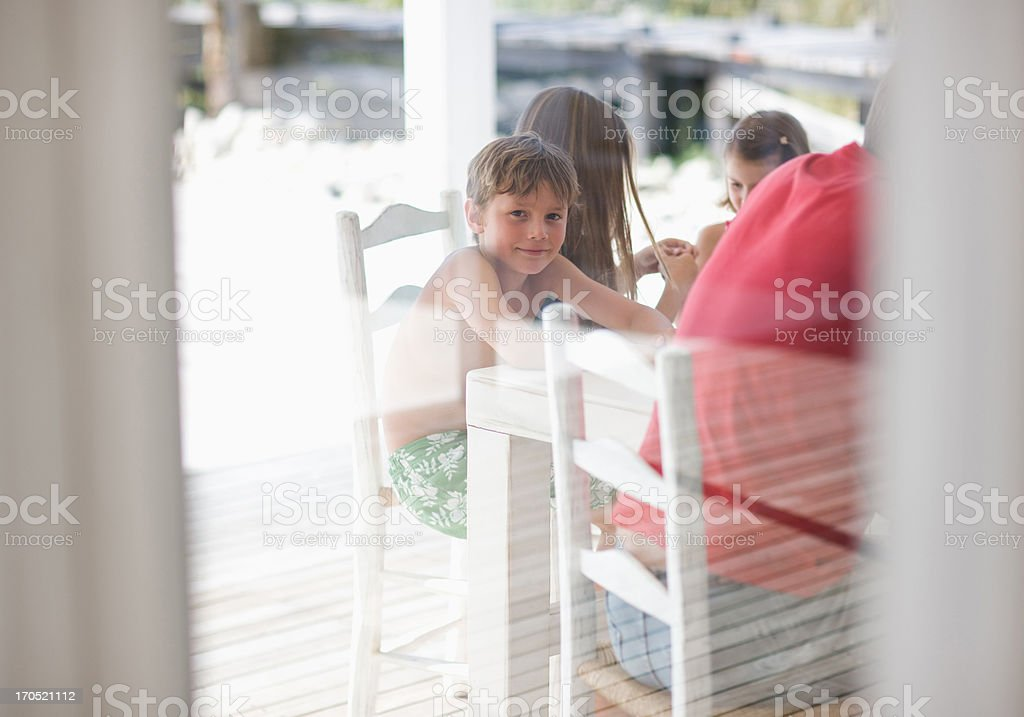 Family sitting at table royalty-free stock photo