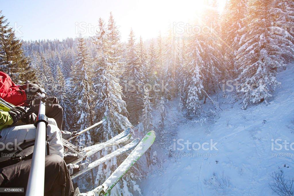 family sitting in ski lift stock photo