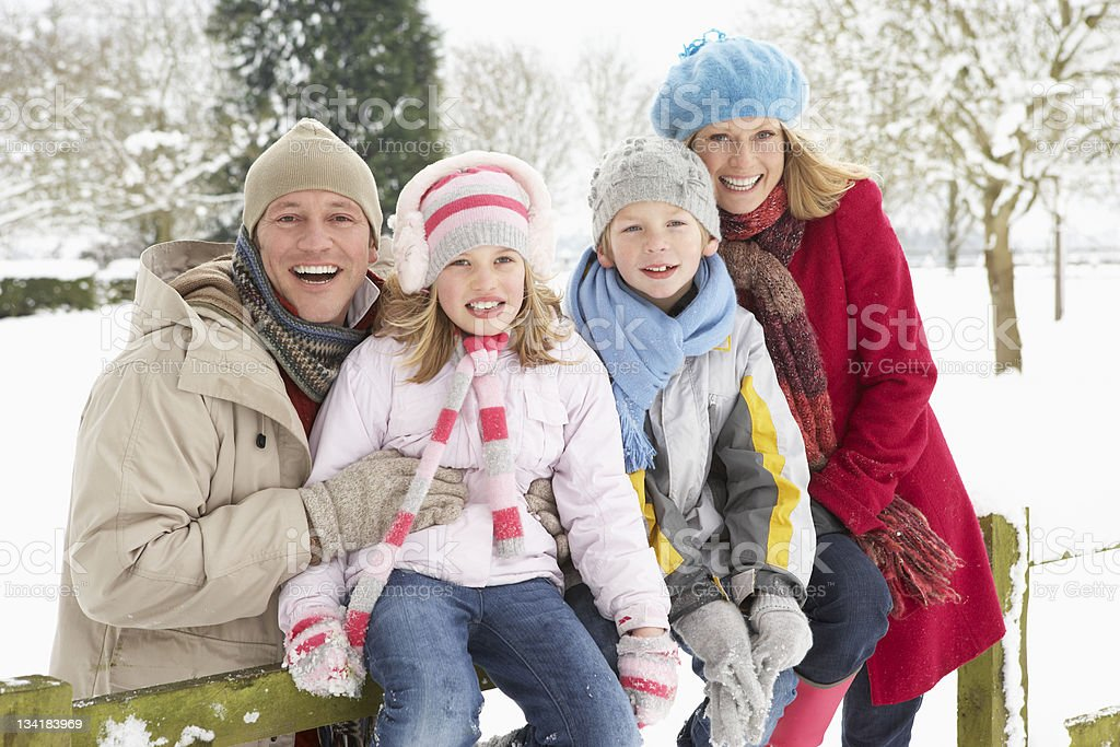 Family Sitting In Snowy Landscape royalty-free stock photo