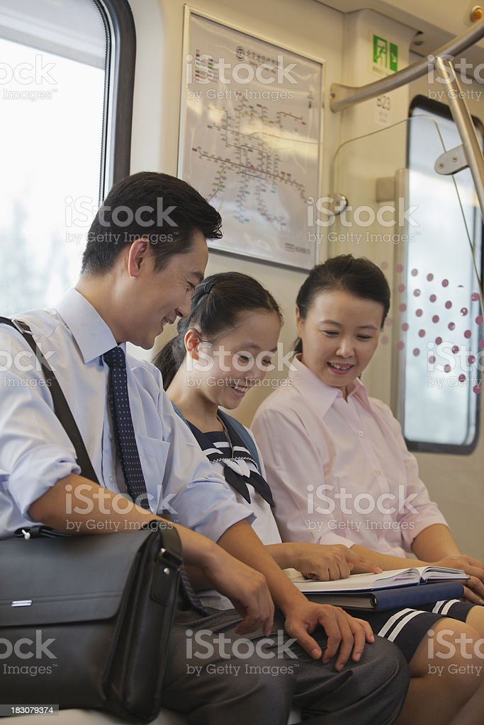 Family sitting in the subway royalty-free stock photo