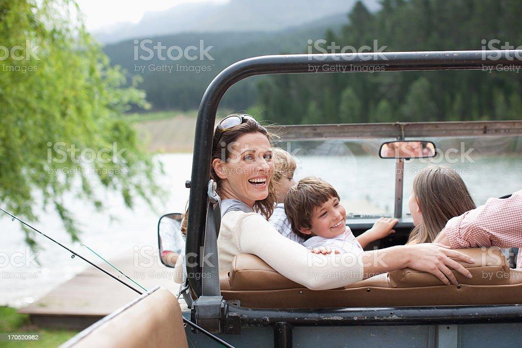 Family sitting in vehicle near lake royalty-free stock photo