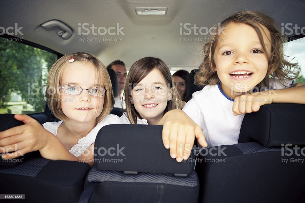 family sitting inside their car royalty-free stock photo