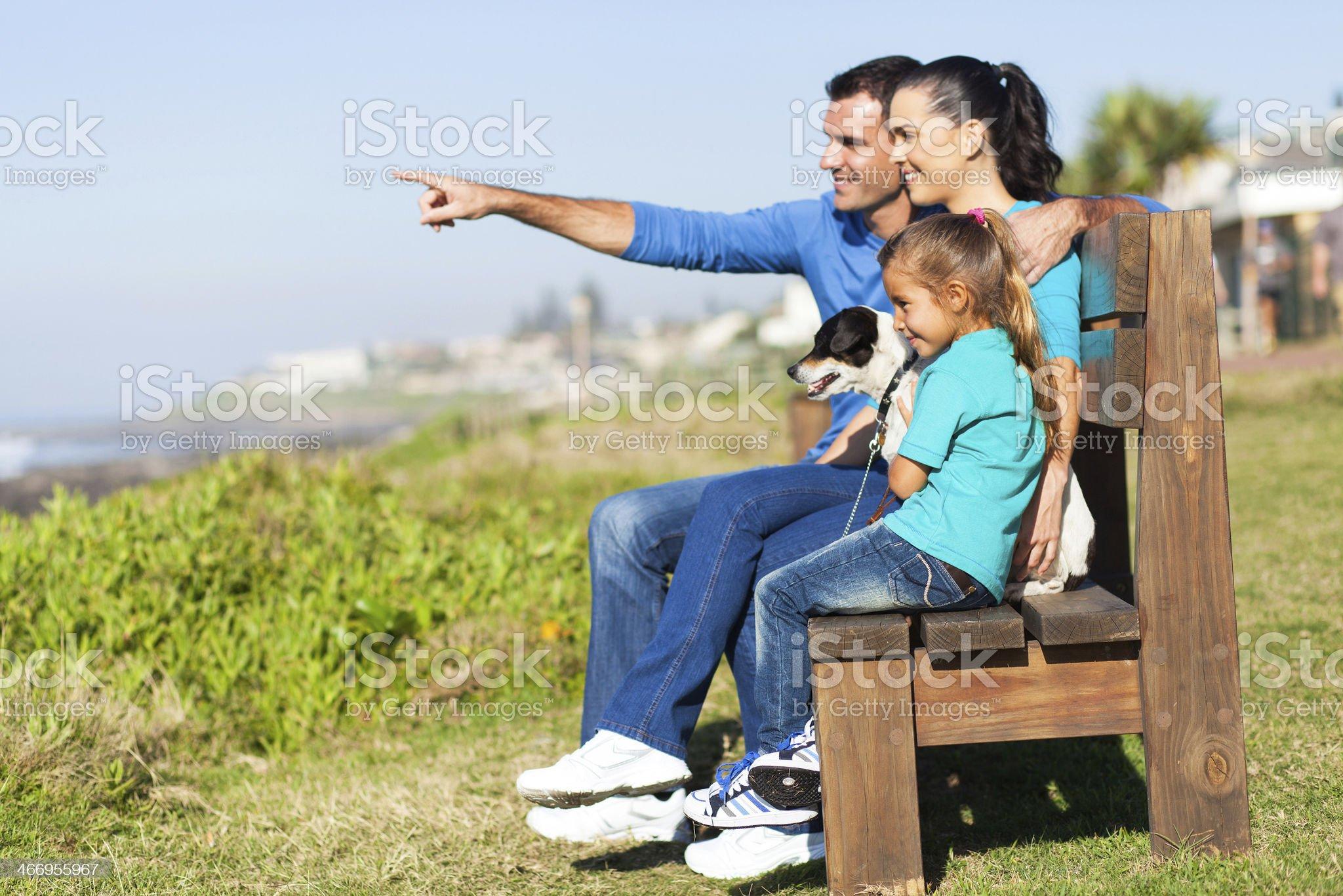 family sitting on beach bench royalty-free stock photo