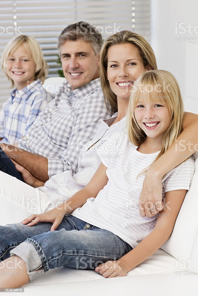 Family Sitting On Couch Smiling royalty-free stock photo
